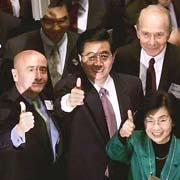NYC 2002:  NYSE Chairman Richard Grasso with Hu Jintao and Mrs Hu
